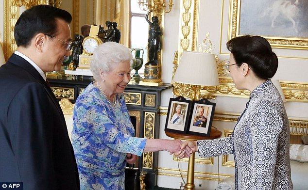 Britain's Queen Elizabeth II (C) receives Chinese Premier Li Keqiang (L) and his wife Cheng Hong (R) at Windsor Castle, in Windsor, west of London, on June 17, 2014 on the first full day of a three day visit by the Chinese premier to Britain.  AFP PHOTO / POOL / STEVE PARSONSSteve Parsons/AFP/Getty Images