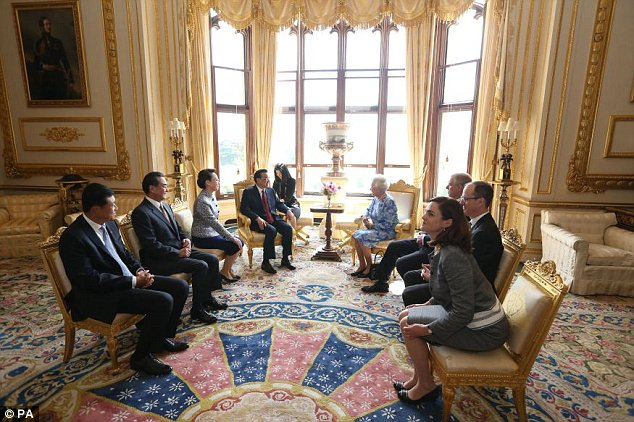 Queen Elizabeth II receives Chinese premier Li Keqiang (fourth left) and his wife Cheng Hong (third left) at Windsor Castle, during their visit to the UK. PRESS ASSOCIATION Photo. Picture date: Tuesday June 17, 2014. Photo credit should read: Steve Parsons/PA Wire