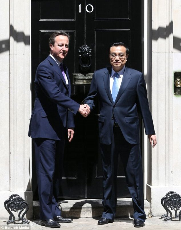 LONDON, UNITED KINGDOM - JUNE 17: British Prime Minister David Cameron meets Chinese Premier Li Keqiang at 10 Downing Street on June 17, 2014 in London, England.  Keqiang is in Britain on a three day trade and cultural visit.    PHOTOGRAPH BY UPI /Landov / Barcroft Media UK Office, London. T +44 845 370 2233 W www.barcroftmedia.com USA Office, New York City. T +1 212 796 2458 W www.barcroftusa.com Indian Office, Delhi. T +91 11 4053 2429 W www.barcroftindia.com