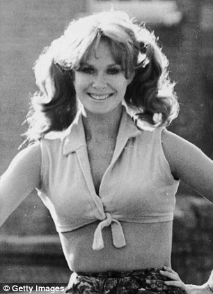 Carol Cleveland, the 'Female Python', pictured here in 1971, was known for her scantily clad roles on Monty Python's Flying Circus