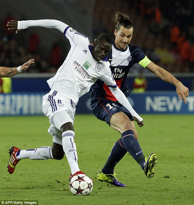 Big game player: Kouyate has Champions League experience - seen here up against Zlatan Ibrahimovic