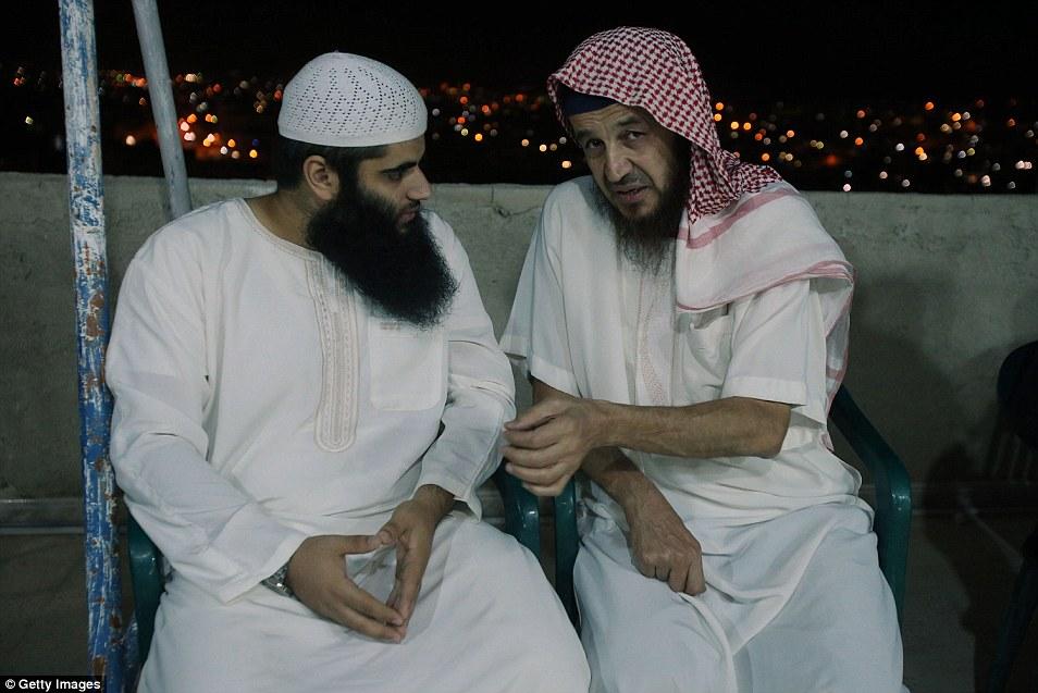 Terror chief: Abu Mohammed al-Maqdessi (pictured, right, talking to son of radical cleric Abu Qatada), once mentored Al Qaeda's infamous Iraq leader Abu Musab al-Zarqawi