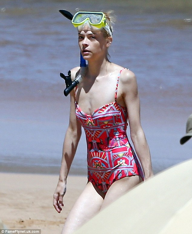 Seeing red: The mother smouldered in a snug red patterned bathing suit