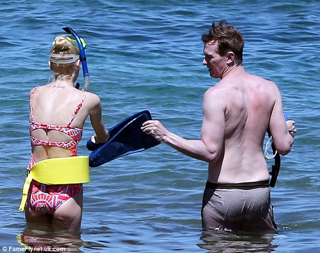 Sharing is caring: The Hart Of Dixie actress grabbed onto one of her husband's blue flippers