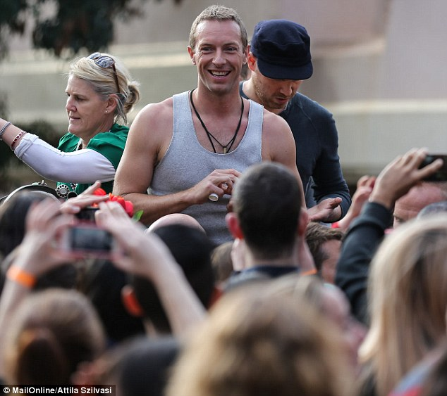 He loves a crowd: The blonde musician enjoyed the enthusiastic fans who turned up for the music video shoot