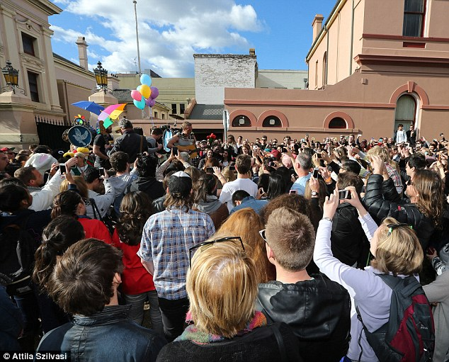 Let's get a glimpse: Hundreds of Coldplay fans surrounded the band to see how they would create a music video in Sydney
