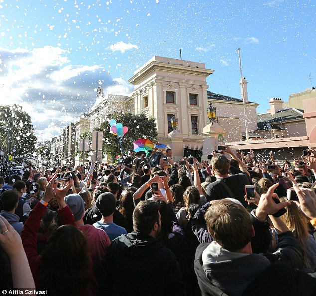 Raving crowd: Coldplay's manager Phil Harvey invited fans to turn up at the Courthouse Hotel in Newtown the next morning and needless to say, hundreds made an appearance