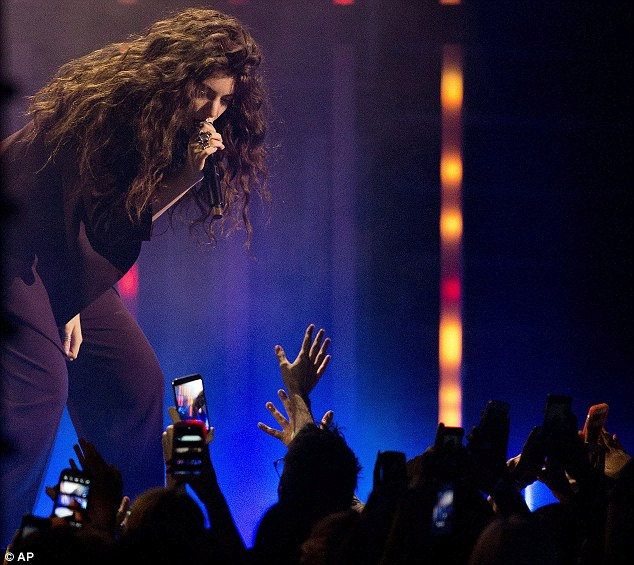 Fan favourite: Lorde performed her new hits Tennis Court and Team at the MuchMusic Video Awards in Toronto on Sunday
