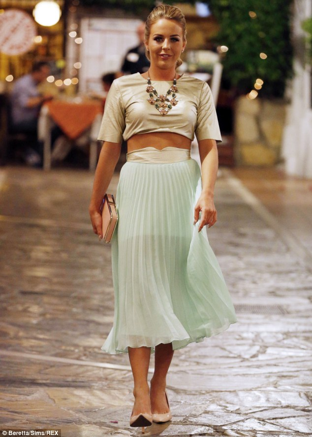 Shimmer and shine: Lydia went for a gold crop top matched with a mint-green sheer skirt and pale pink accessories