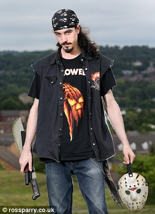 The unemployed 26-year-old horror fan with the fake weapons and the mask from his costume