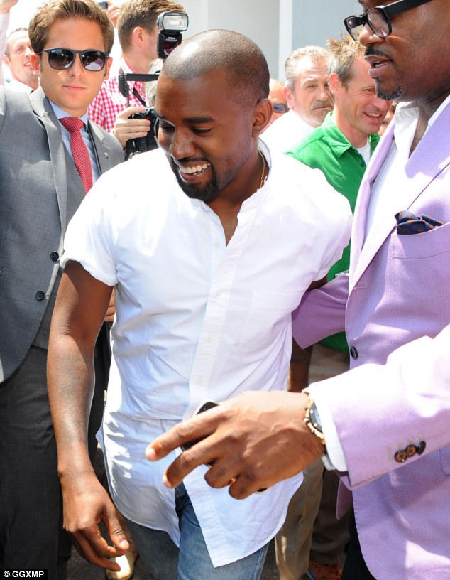 Wild, wild, West: Kanye had a big smile on his face as he arrived at Cannes Lions 2014 on the French Riviera