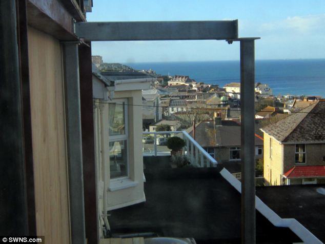 Balconies: Balconies have also been erected next to Mrs Reynolds' windows in Newquay, Cornwall