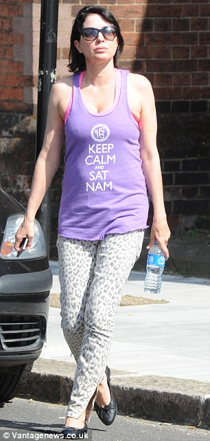 'Keep Calm and Sat Nam': Sadie stood out from the group in her purple vest and leopard print jeans