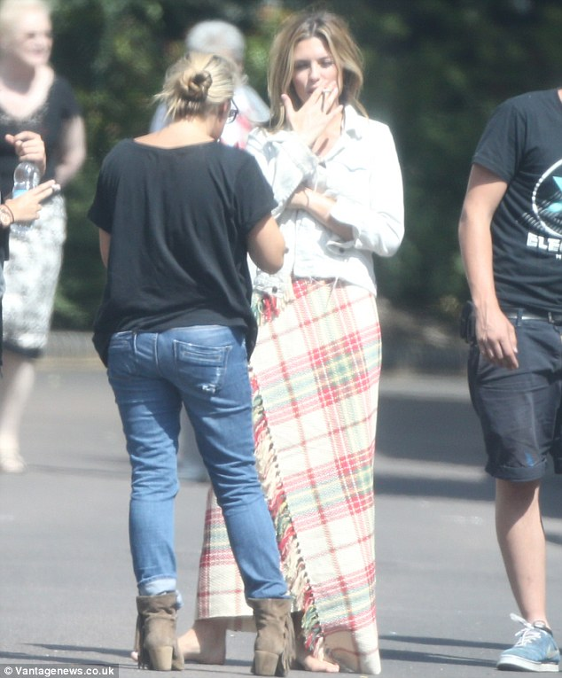 No so smoking hot! The mother-of-one was seen indulging in a cigarette after wrapping her bottom half in a checked blanket