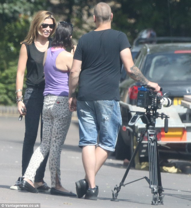 Nice day for it: The Strictly Come Dancing winner was joined on set by actress Sadie Frost