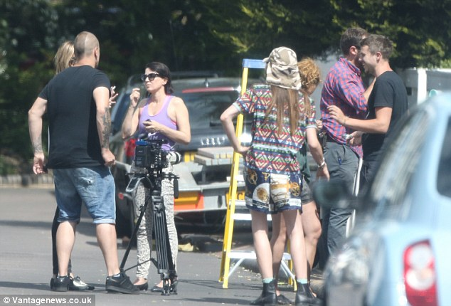 Huddle: Sadie, who was previously married to actor Jude Law, was seen seen chatting to the cameraman