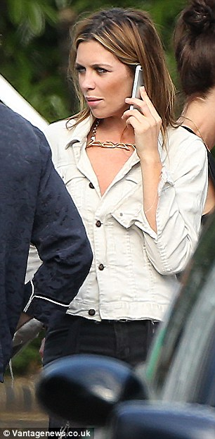 Is that Peter? Abbey teamed her pale denim jacket with a chunky gold necklace while chatting away on her phone