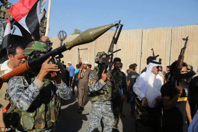 Pushing back: Iraqi Shiite tribesmen are joining state-run security forces in the fight against Jihadist militants who have taken over several northern Iraqi cities; Iraq's US ambassador says his country needs America's help to prevent 'a thousand' Bin Ladens from turning the globe into a terrorist shooting gallery