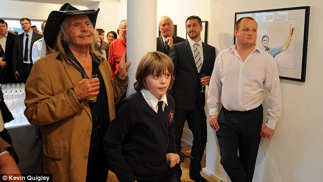 Master and the apprentice: Trevilion looks on with his son John, aged 9