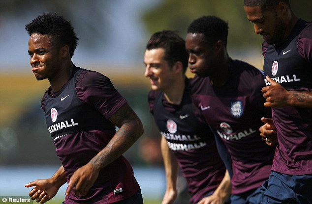 Focused: Sterling (left) and his England team-mates train ahead of Thursday's clash with Uruguay