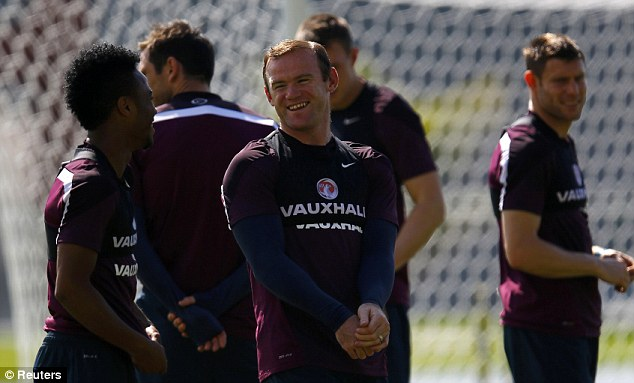 Teacher: Sterling (left) says he learns things every day from Rooney (right) in training