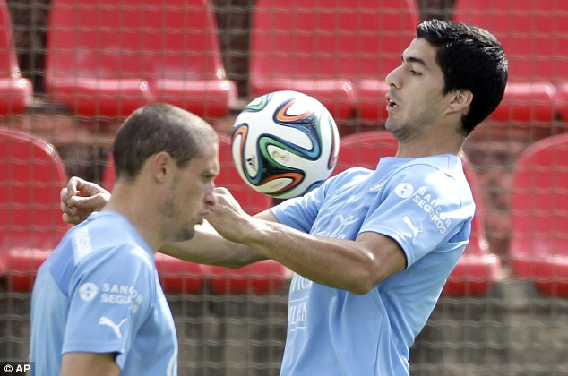 Feared: Uruguay's Luis Suarez (right) is not a player who Sterling wants to see line-up against England