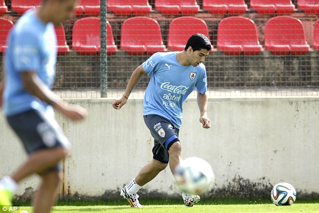 Fitness battle: Suarez has been training following knee surgery but is a doubt to start against England