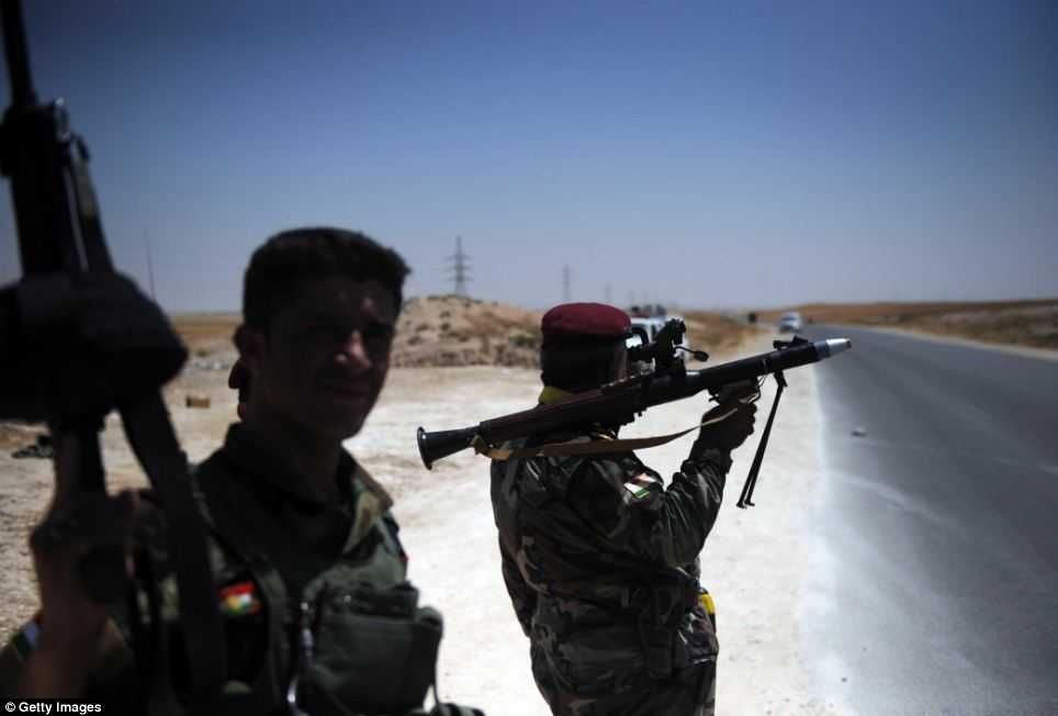 Kurdish peshmerga forces keep guard around Tal Afar of Mosul where ISIL, the Islamic State of Iraq and the Levant, took hold and cover with fire the surrounding villages where the residents keep abandoning towards Sinjar
