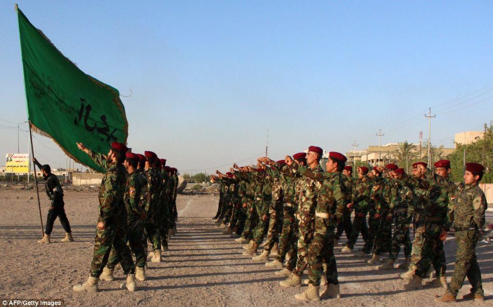 Members of the Shiite Muslim Mehdi Army militia, take part in training in the southern Iraqi city of Basra