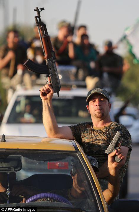 Faced with a militant offensive sweeping south toward Baghdad, Prime Minister Nuri al-Maliki announced the Iraqi government would arm and equip civilians who volunteer to fight, and thousands have signed up