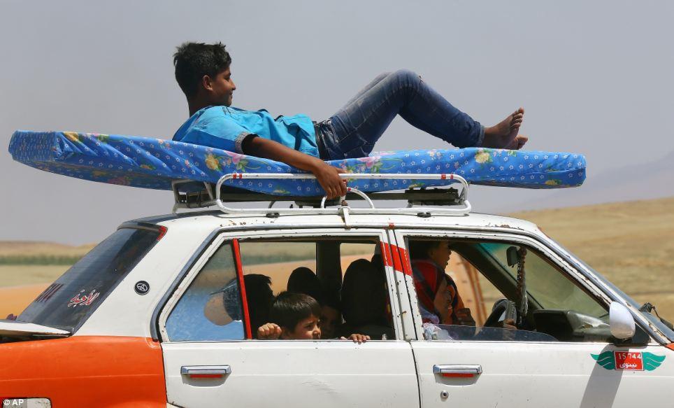 Refugees in the largely-autonomous Kurdish area of Dahuk, 260 miles northwest of Baghdad