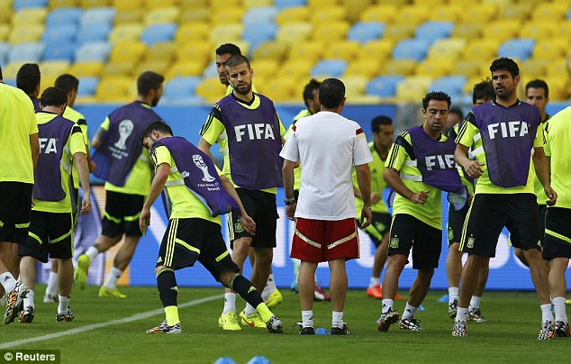 Preparing: The Spanish players train ahead of their match against Chile on Wednesday