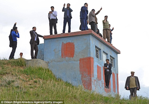 I found signal! It's hard for these residents of the remote eastern Turkish district of Baskale to have a phone call in private - as they all have to troop half a mile up a hill together to get signal on their mobiles