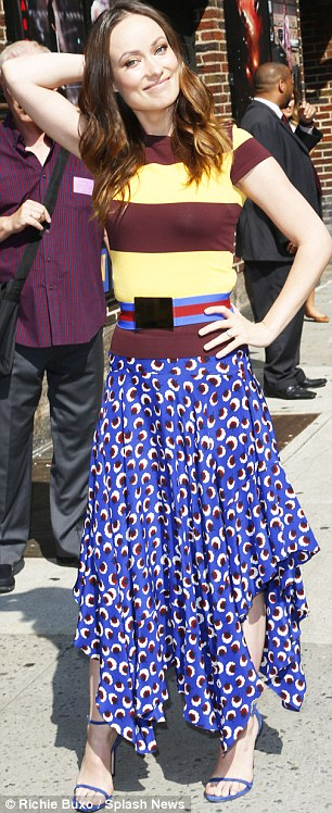 Still svelte: The House star  wore a thick blue and red striped belt over a tight-fitting rugby striped top, patterned blue maxi skirt, and blue stilettos on the outing
