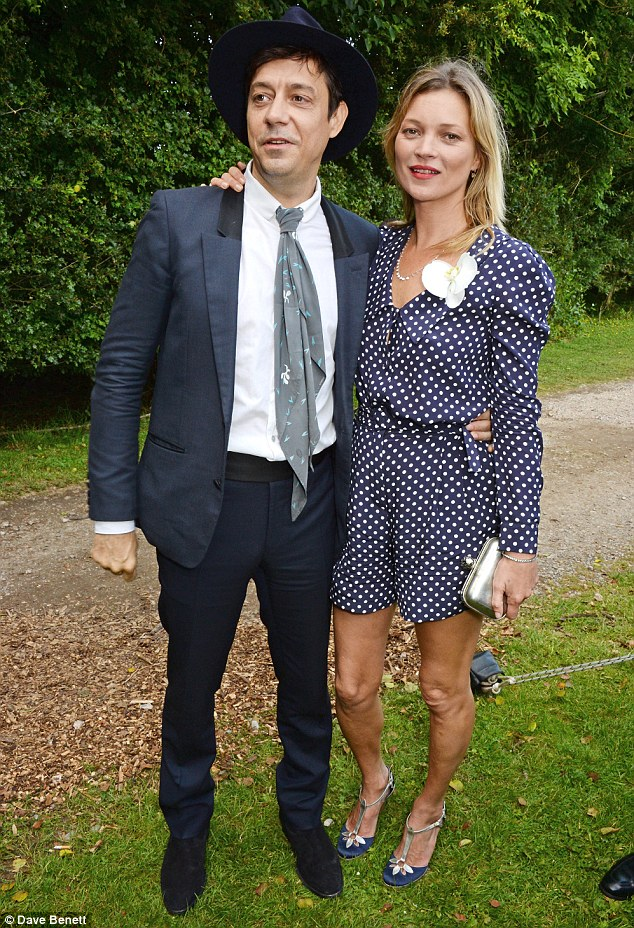 Stylish couple: Jamie Hince (L) and Kate Moss attend John Hitchcox and Phoebe Vela's wedding