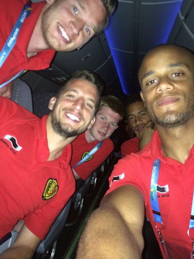 Selfie: Belgium captain Vincent Kompany (right) tweeted this photo on the plane after the match