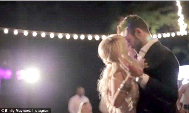 Dancing the night away: The newlyweds gazed at each other intently as their twirled around the dance floor