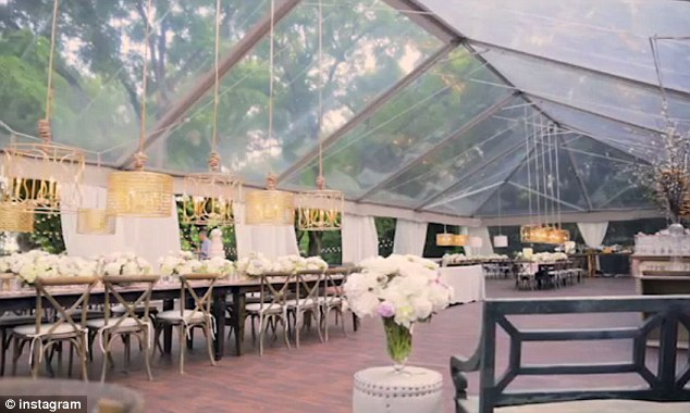 Let the fun begin! A flash of the wedding reception showed off the outdoor party sheltered within a transparent tent
