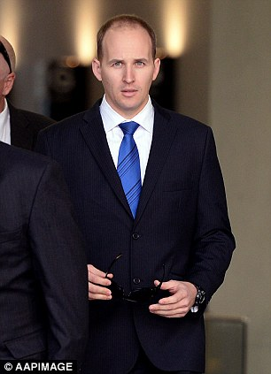 Senior Constable Cameron Simmons leaves the Supreme Court in Brisbane, Wednesday, June 18, 2014
