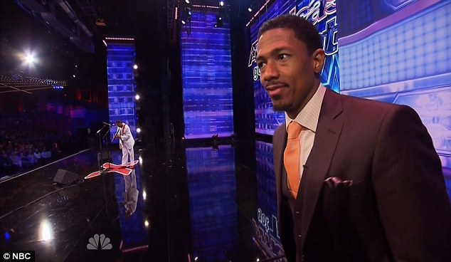 The host: Show host Nick Cannon joked that 30 years from now he would look like Dr Benji, shown in the background