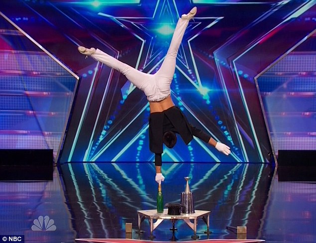 Circus act: Christian Stoinev showed strength and skill during his hand-balancing act