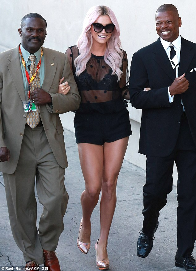 Sheer daring: Kesha arrived to Jimmy Kimmel with two escorts on Tuesday in Hollywood