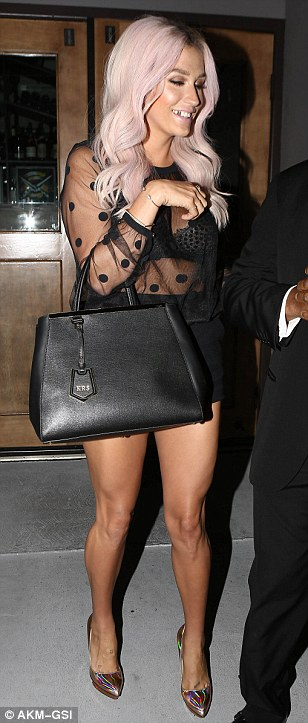 Nice to see you: Kesha opted for the same see through shirt for dinner at Crossroads Vegan Restaurant later in the day