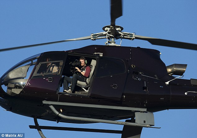 Riding high: The duo made a dramatic entrance, via a helicopter ride that showcased the seaside setting