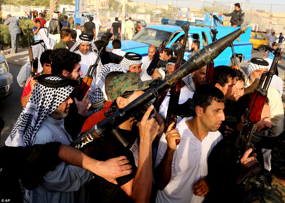 Frontline fighters: Thousands of Shi'ites from across southern Iraq have reportedly answered a call to arms as Al Qaeda-inspired militants bore down on the capital