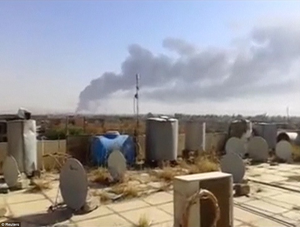 Flashpoint: A plume of smoke rises from what is said to be Baiji oil refinery in northern Iraq, where ISIS have reportedly seized control of three-quarters of the plant