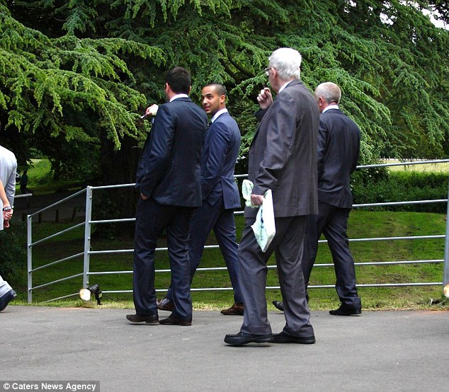Suited and booted: Theo looked relaxed as he headed towards the venue