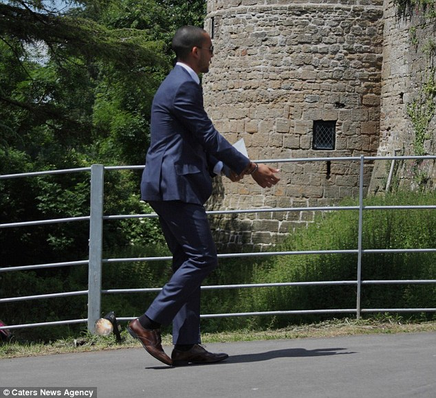 Heading inside: Arsenal star Theo also looked smart in his suit outside the venue