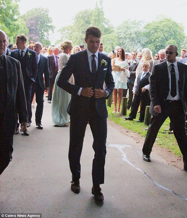 Dapper: Caldicot councillor John Marshall welcomed the star - who was born in nearby Caerphilly, south Wales - and praised him for getting hitched locally