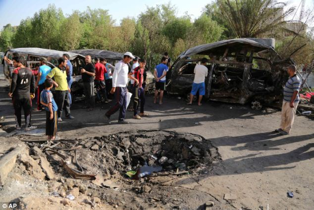 Getting closer: As ISIS moves toward Baghdad, its militants are detonating car bombs in the city, like this lethal blast on Wednesday in Baghdad's Shia-dominated Sadr City region